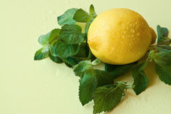 Lemon and mint. With in the drops of water Stock Image