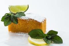 Lemon and mint cake isolated on white background. Slice of lemon cake with mint Stock Photography