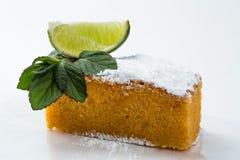 Lemon and mint cake isolated on white background. Slice of lemon cake with mint Stock Photo