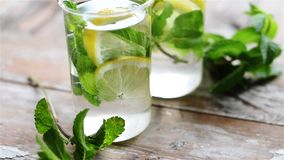 Lemon and mint drink stock video