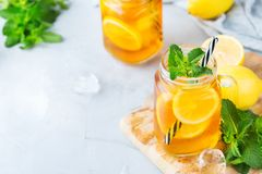 Lemon mint iced tea cocktail refreshing drink for summer days. Food and drink, holidays party concept. Lemon mint iced tea cocktail refreshing drink beverage in royalty free stock photo