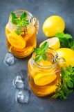 Lemon mint iced tea cocktail refreshing drink for summer days. Food and drink, holidays party concept. Lemon mint iced tea cocktail refreshing drink beverage in royalty free stock image