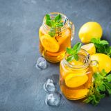 Lemon mint iced tea cocktail refreshing drink for summer days. Food and drink, holidays party concept. Lemon mint iced tea cocktail refreshing drink beverage in royalty free stock images