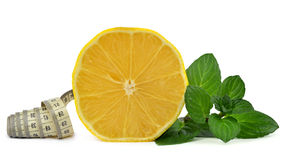 Lemon with mint leaves and measuring tape Royalty Free Stock Images