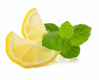 Lemon and mint leaves  on white Stock Image