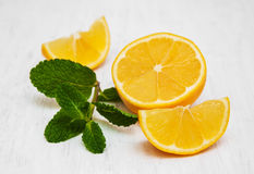 Lemon and mint. On a old white wooden background Stock Photo