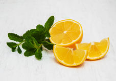 Lemon and mint. On a old white wooden background Stock Photos