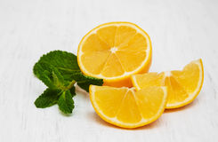 Lemon and mint. On a old white wooden background Royalty Free Stock Photography