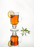 Lemon and mint tea in glass teacup Stock Image