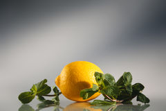 Lemon and mint on a white grey background. Selective focus Royalty Free Stock Photos