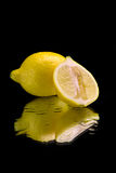 Lemon on mirror. And drops of water royalty free stock photos