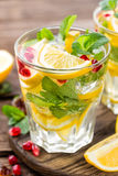 Lemon mojito cocktail with mint and pomegranate Stock Photo