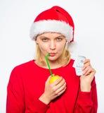 Lemon money concept. Symbol of wealth and richness. Rich girl with lemon and money. Girl santa hat drink juice lemon. While hold pile money. Make money on fresh stock photo