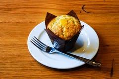 Lemon Muffin. Baked Lemon Muffin on the white dish royalty free stock photo