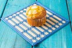 Lemon Muffin. Fresh Lemon muffin on vintage blue wood table royalty free stock photo