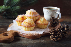 Lemon muffins, cop of coffee and pine cones Stock Photo
