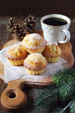 Lemon muffins, cop of coffee and pine cones Royalty Free Stock Photos