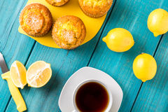 Lemon Muffins with cup of tea / coffee Stock Photo