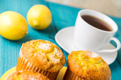Lemon Muffins with cup of tea / coffee Royalty Free Stock Images