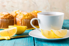 Lemon Muffins with cup of tea / coffee Stock Images