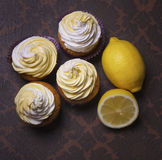 Lemon muffins cupcakes with butter cream Royalty Free Stock Photo