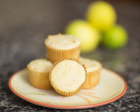 Lemon muffins. Delicious lemon muffins with lemons in the background Royalty Free Stock Photography