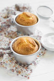 Lemon muffins in tins for baking Royalty Free Stock Images