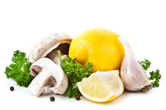 Lemon and mushrooms Stock Image