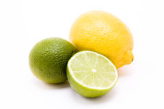 Lemon n Lime. Yellow lemon and green lime against plain white background stock photos