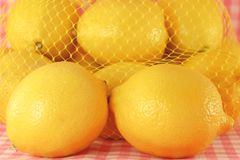 Lemon with net Royalty Free Stock Photos