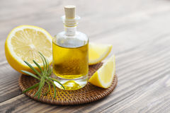 Lemon oil in a glass bottle Royalty Free Stock Photography
