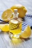 Lemon oil in a glass bottle Stock Image