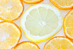 Lemon and orange. Orange and lemon slices on white background Royalty Free Stock Images