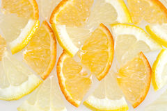 Lemon and orange. Orange and lemon slices on white background Stock Photography