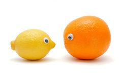 Lemon and orange with eyes Stock Photos