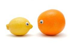 Lemon and orange with eyes Stock Photos