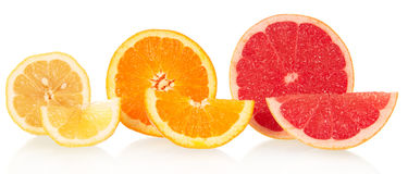 Lemon, orange and grapefruit in a cross-section Stock Photos