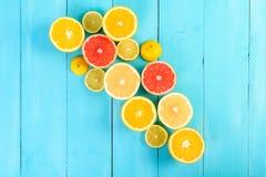 Lemon, Orange, Grapefruit And Lime Citrus Fruit Slices. On Turquoise Table Royalty Free Stock Photography