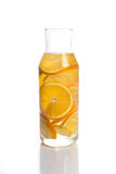 Lemon and orange infused water in a decanter Royalty Free Stock Photos