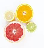Lemon, orange, lime and grapefruit. On white royalty free stock images