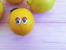 Lemon orange exotic cartoon looking eyes wooden personage. Lemon orange personage  cartoon eyes wooden looking exotic Stock Images