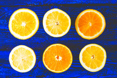 Lemon and orange slices on the blue wooden background top view Stock Photography