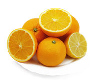 Lemon and oranges on a plate Stock Image