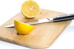 Lemon over chopping board. Sliced fresh lemon over chopping board Stock Photography