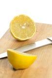 Lemon over chopping board. Sliced fresh lemon over chopping board Royalty Free Stock Image