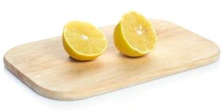 Lemon over chopping board. Sliced fresh lemon over chopping board Royalty Free Stock Photos