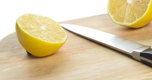 Lemon over chopping board. Sliced fresh lemon over chopping board Royalty Free Stock Photo