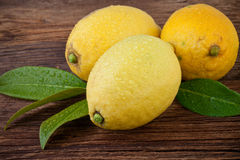 Lemon over Wooden background Royalty Free Stock Photo