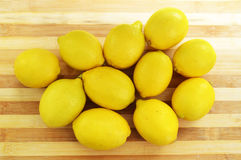 Lemon paintings on the finest wooden chopping board Stock Photo