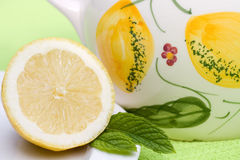 Lemon part with a jug of water. Lemon part with on the background a jug of lemon flavored water Stock Photo
